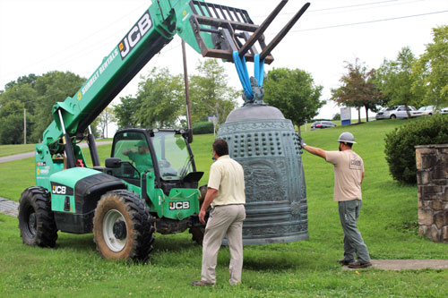 Crews move the Friendship Bell to its new location in A.K. Bissell Park